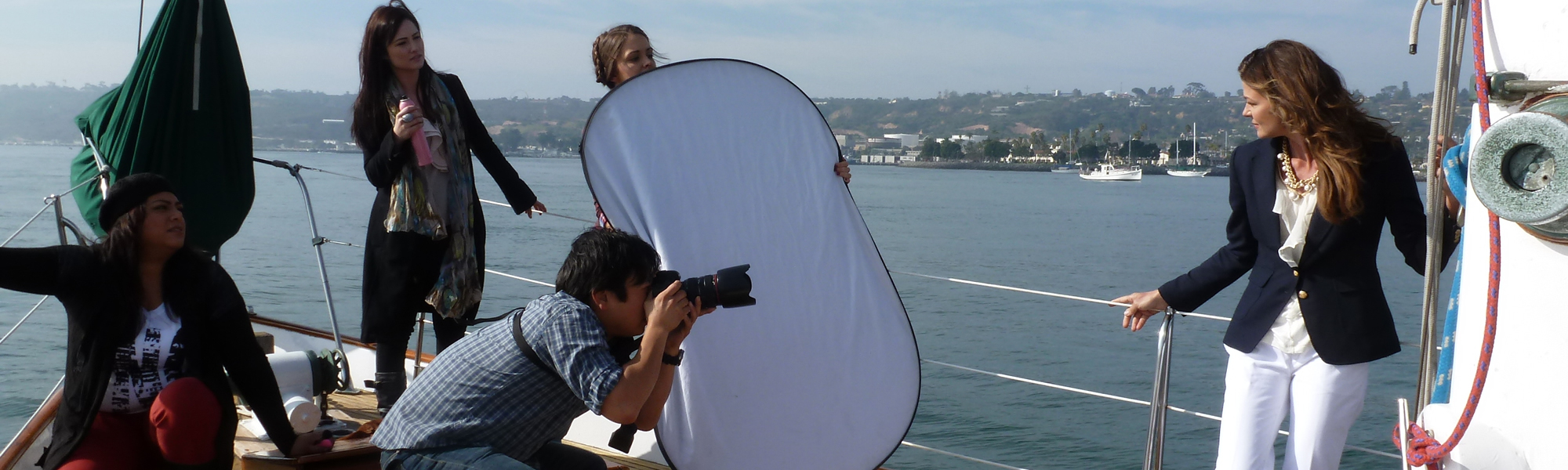 Charter a photo shoot at sea in San Diego on JADA - classic wooden sailboat
